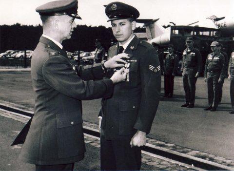 A1C Franklin J. Vinson awarded AF Commendation Medal by Col. Edwards
