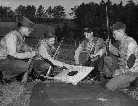 MSgt. James Cazel reviews groupings with fellow marksmen at Sembach A.B. range. Circa 1960