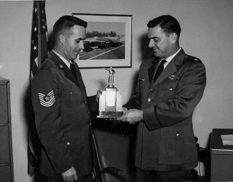 2 November 1960 - MSgt. James E. Cazel presents trophy to Base Commander Col. D. Brawner